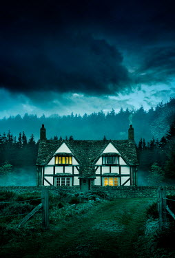 Stephen Mulcahey LIGHTS IN TUDOR HOUSE IN COUNTRYSIDE AT DUSK Houses