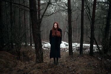 Ulyana Naydenkova GIRL WITH RED HAIR STANDING IN WINTRY FOREST Women