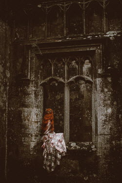 Rebecca Stice Young woman sitting in window of abandoned castle
