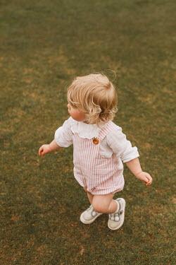 Shelley Richmond Toddler walking in grass