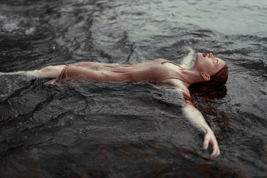 Ulyana Naydenkova Young woman floating in sea