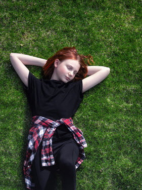 Elisabeth Ansley Teenage girl lying in grass from above