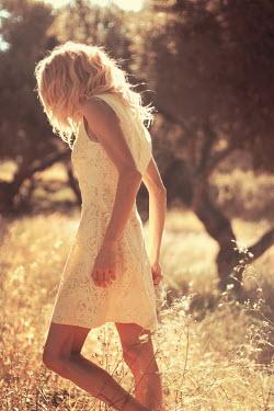 Irene Lamprakou Young woman in white dress in field