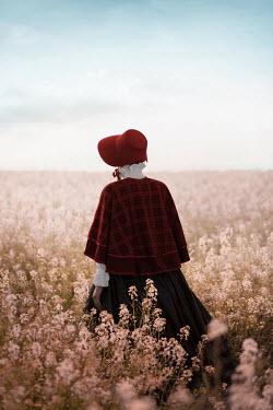 Ildiko Neer Historical woman standing in flower field