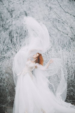 Jovana Rikalo Young woman in white dress in winter