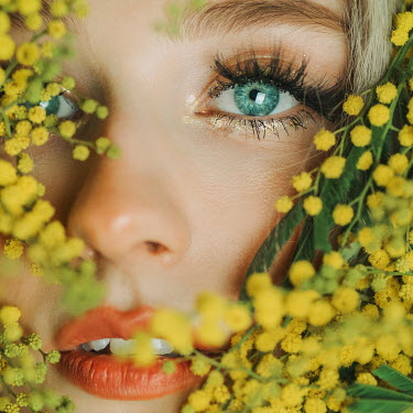 Jovana Rikalo Close up of young woman with yellow flowers