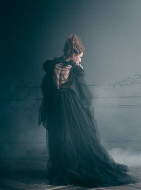 Irina Orwald WOMAN IN BLACK DRESS IN GRAND HOUSE WITH SMOKE Women