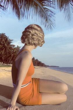 ILINA SIMEONOVA 1930S WOMAN IN SWIMSUIT ON BEACH WITH PALM TREES Women