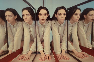 Ulyana Naydenkova SERIOUS BRUNETTE WOMAN REFLECTED IN MIRRORS Women