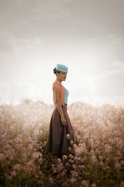 Ildiko Neer Retro woman standing in flower field