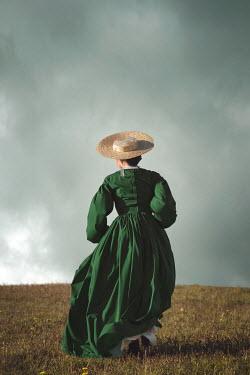 Joanna Czogala HISTORICAL WOMAN IN HAT RUNNING IN COUNTRYSIDE Women