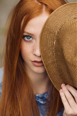Nina Masic GIRL WITH RED HAIR COVERING FACE WITH HAT Women