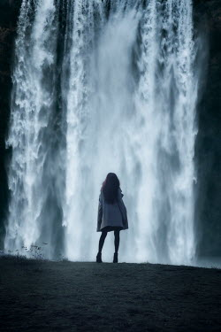 Nic Skerten GIRL STANDING WATCHING WATERFALL FROM BEHIND Women