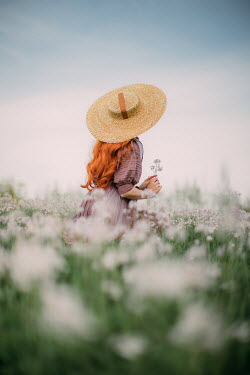 Rebecca Stice WOMAN WITH RED HAIR AND HAT SITTING IN SUMMERY MEADOW Women