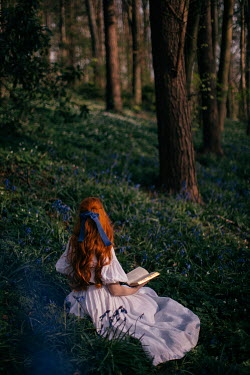 Rebecca Stice WOMAN WITH RED HAIR SITTING READING IN FOREST Women
