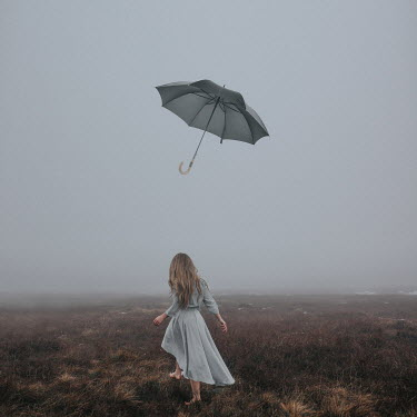 Rosie Hardy WOMAN ON FOGGY MOORLAND WITH FLOATING UMBRELLA Women