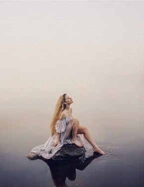 Rosie Hardy BLONDE WOMAN SITTING ON ROCK IN LAKE Women