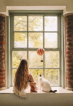 Rosie Hardy WOMAN AND CAT WITH TOY HOT AIR BALLOON IN WINDOW Women