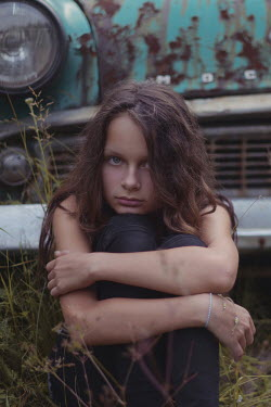 Anna Rakhvalova SAD GIRL SITTING BY RUSTY CAR Children