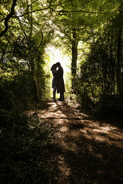CollaborationJS SILHOUETTED COUPLE EMBRACING ON COUNTRY PATH Couples