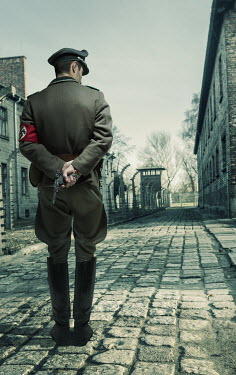 CollaborationJS A german officer walking through Auschwitz-Birkenau