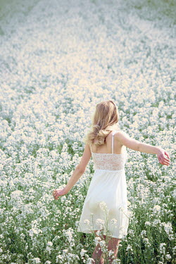 Carmen Spitznagel BLONDE WOMAN IN WHITE SUMMERY FIELD Women