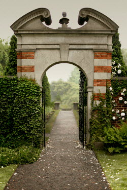 ILINA SIMEONOVA OPEN STONE GATEWAY WITH PATH IN GARDEN Gates