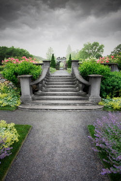 ILINA SIMEONOVA STONE STEPS AND GATEWAY IN GARDEN WITH STORMY SKY Stairs/Steps