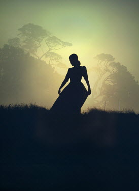 Mark Owen SILHOUETTED GIRL IN FIELD AT SUNSET Women