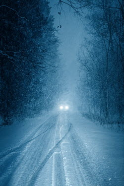 Magdalena Russocka car with headlights on snowy country road