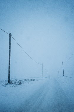 Magdalena Russocka empty country road in blizzard
