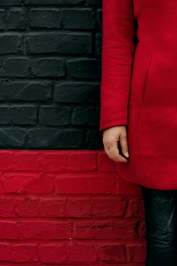 Maria Petkova GIRL IN COAT STANDING BY RED AND BLACK WALL Women