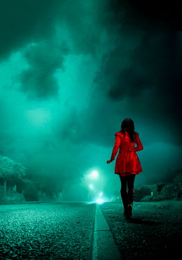 Stephen Mulcahey A woman running along a road at night
