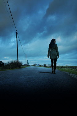 Stephen Mulcahey A woman walking a long a road