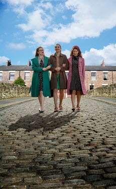 Stephen Mulcahey three women dressed in forties clothing walking towards camera