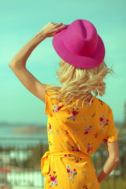 Irene Lamprakou Young woman in yellow dress with pink hat