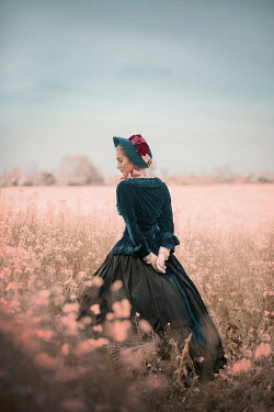 Ildiko Neer Victorian woman standing in flower field