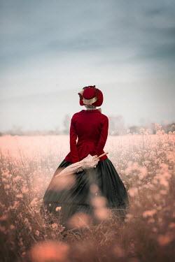 Ildiko Neer Victorian woman holding parasol in flower field