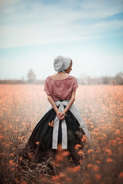 Ildiko Neer Historical servant standing in flower field