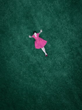 Magdalena Russocka aerial view of teenage girl sitting on grass