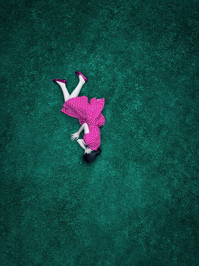 Magdalena Russocka aerial view of teenage girl lying on grass