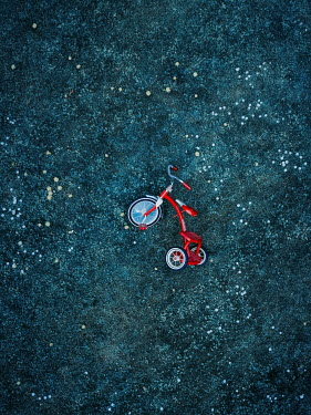 Magdalena Russocka Abandoned tricycle in field from above