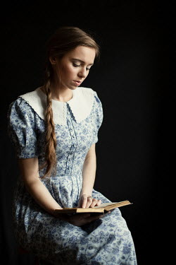 Magdalena Russocka young woman reading book