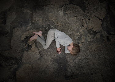Sveta Butko Boy lying on concrete from above
