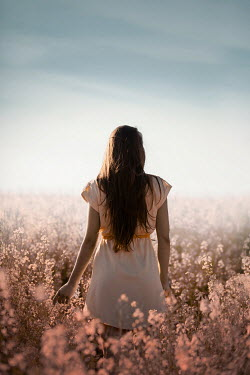 Ildiko Neer Brown hair woman standing in flower field