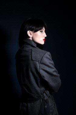 Miguel Sobreira Woman in Grey Coat  in Shadows