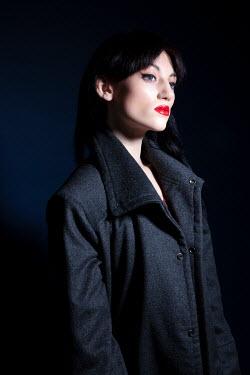 Miguel Sobreira Pensive Woman in Grey Coat