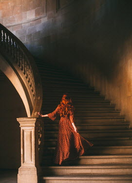Rebecca Stice Woman walking on stone staircase