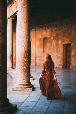 Rebecca Stice Young woman walking by pillars