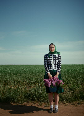Felicia Simion WOMAN IN HEADSCARF WITH BASKET OF FLOWERS IN COUNTRYSIDE Women